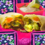 Tropical spring rolls with spicy peanut dressing